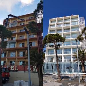 Grandes ventanales de aluminio cubren la nueva fachada del Hotel Aromar